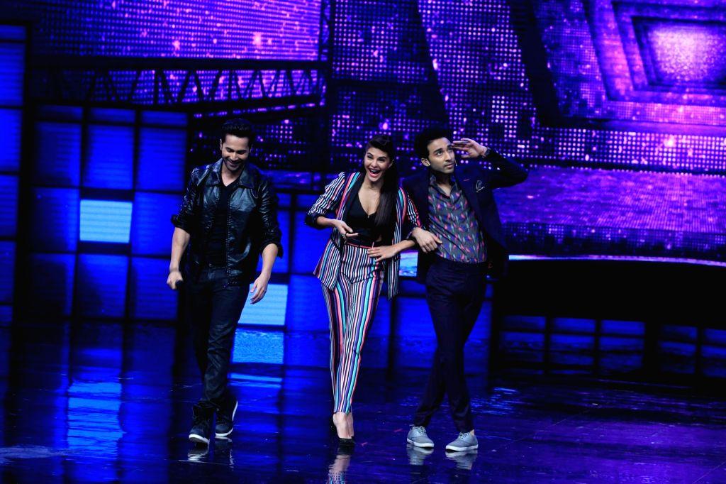 Actors Varun Dhawan, Jacqueline Fernandez and Dancer actor Raghav Juyal on the sets of Star Plus dance reality show Dance + (Dance Plus) season 2, to promote upcoming film Dishoom in Mumbai ... - Raghav Juyal, Varun Dhawan, Jacqueline Fernandez and Dancer
