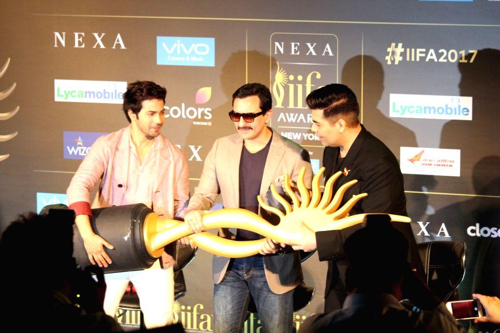 Actors Varun Dhawan, Saif Ali Khan and film director Karan Johar during the press conference of 18th International Indian Film Academy (IIFA) awards in Mumbai, on June 18, 2017. - Karan Johar, Varun Dhawan and Saif Ali Khan