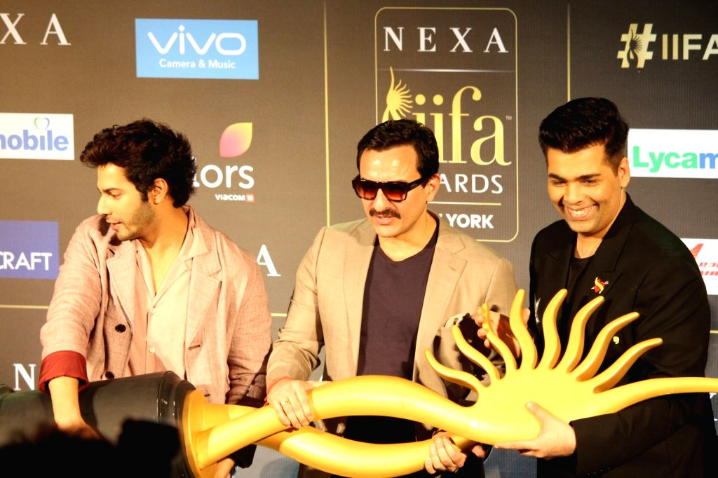Actors Varun Dhawan, Saif Ali Khan and film director Karan Johar during the press conference of 18th International Indian Film Academy (IIFA) awards in Mumbai, on June 18, 2017. - Karan Johar, Varun Dhawan and Saif Ali Khan