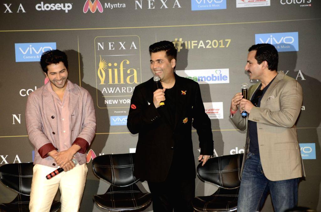 Actors Varun Dhawan, Saif Ali Khan and filmmaker Karan Johar during the press conference of 18th International Indian Film Academy (IIFA) awards in Mumbai on June 19, 2017. - Varun Dhawan, Saif Ali Khan and Karan Johar
