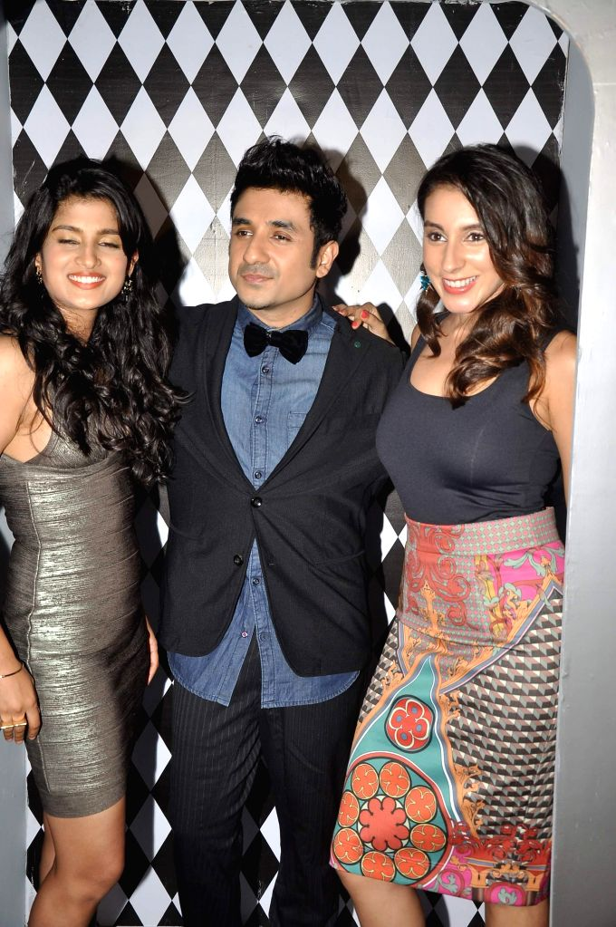 Actors Vega Tamotia Vir Das and Anindita Nayar during the music launch of film Amit Sahni Ki List in Mumbai on June 18, 2014. - Vega Tamotia Vir Das and Anindita Nayar