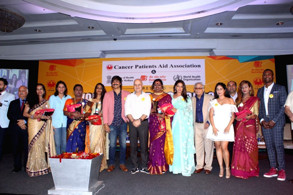 Actors Vivek Oberoi and Anupam Kher and Congress leader Priya Dutt during a programme organised to celebrate 'World No Tobacco Day', in Mumbai on May 30, 2018. - Vivek Oberoi, Anupam Kher and Priya Dutt