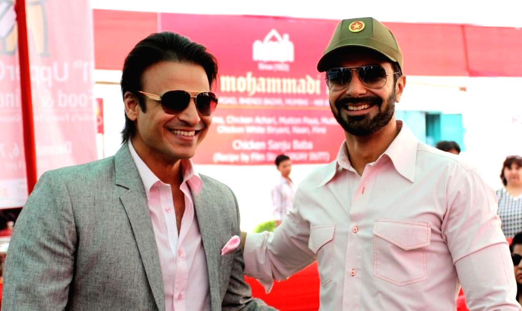 Actors Vivek Oberoi and Ashmit Patel during the 11th UpperCrust Food and Wine Show in Mumbai on Dec.6, 2013. - Vivek Oberoi and Ashmit Patel