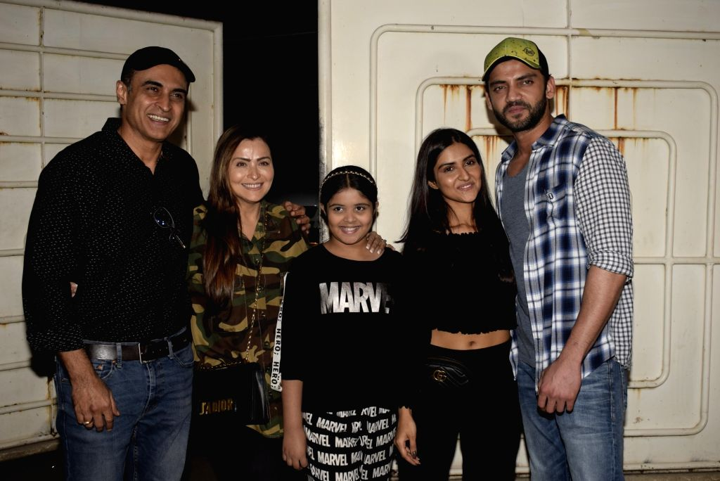 "Actors Zaheer Iqbal and Pranutan, with her family at the screening of their upcoming film ""Notebook"" in Mumbai, on March 4, 2019. - Zaheer Iqbal and Pranutan"