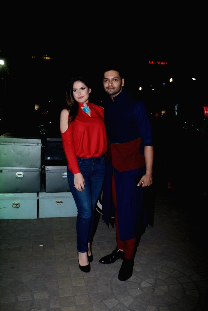 "Actors Zareen Khan and Ali Fazal during the special screening of film ""Victoria & Abdul"" in Mumbai on Oct 5, 2017. - Zareen Khan and Ali Fazal"