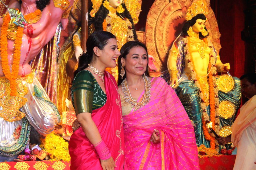 Actorss Kajol and Rani Mukerji during Durga Navami celebrations at a Juhu Durga Puja pandal in Mumbai on Oct 7, 2019. 9Photo: IANS) - Kajol