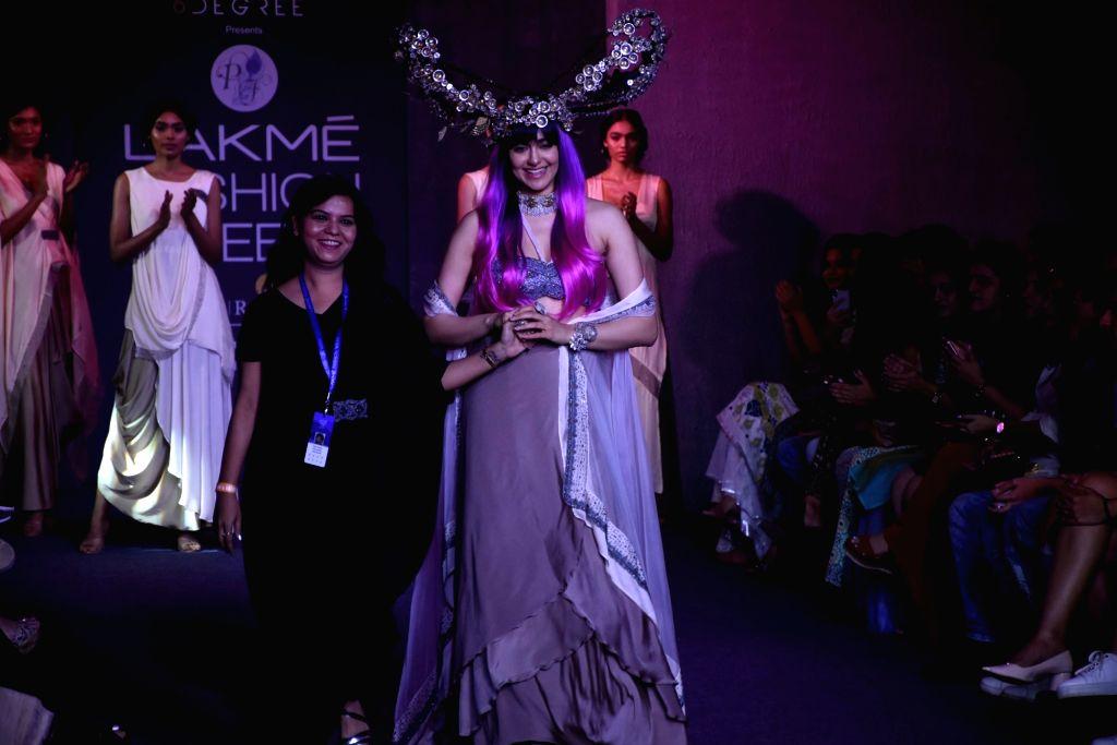 Actress Adah Sharma with fashion designer Pinkey Agarwal at Lakme Fashion Week Winter/Festive 2019, in Mumbai on Aug 24, 2019. - Adah Sharma