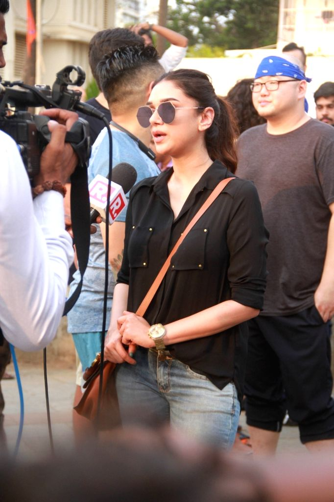 Actress Aditi Rao Hydari during peaceful protest against the barbaric rape and murder of an eight-year-old girl in Kathua in Jammu and Kashmir, and sexual assault of another young girl in ... - Aditi Rao Hydari
