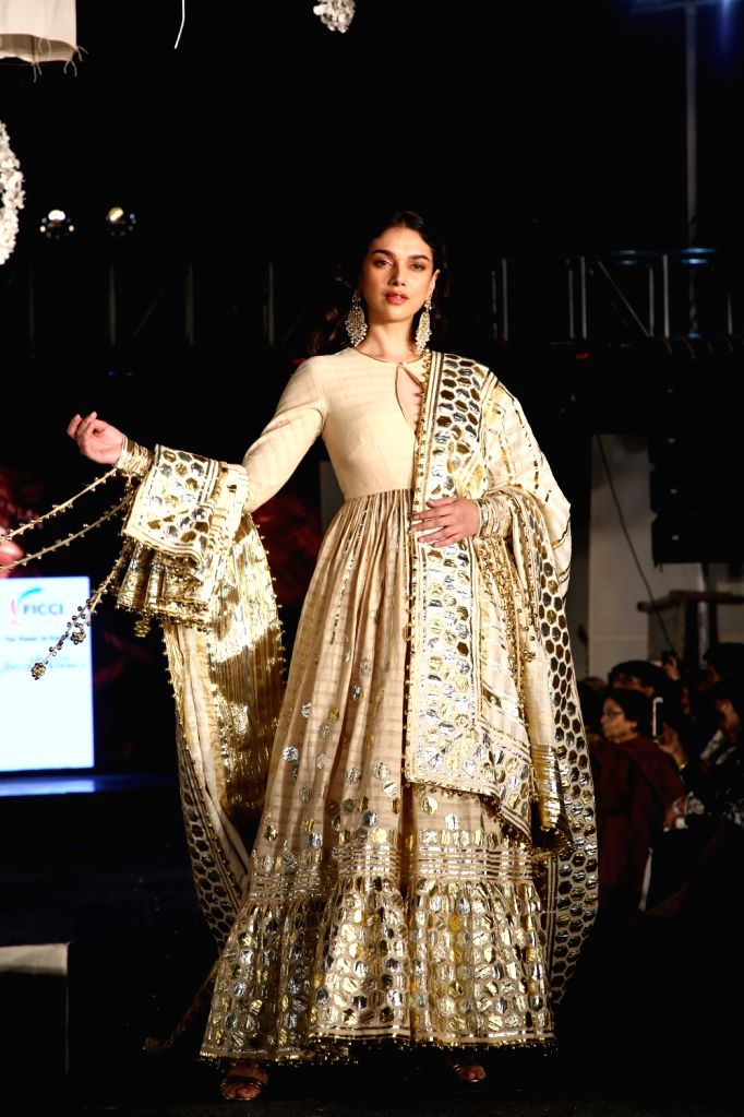 "Actress Aditi Rao Hydari showcases creations of fashion designer duo Abu Jani and Sandeep Khosla during ""Khadi Goes Global"" programme, in New Delhi, on Feb 21, 2019. - Aditi Rao Hydari"