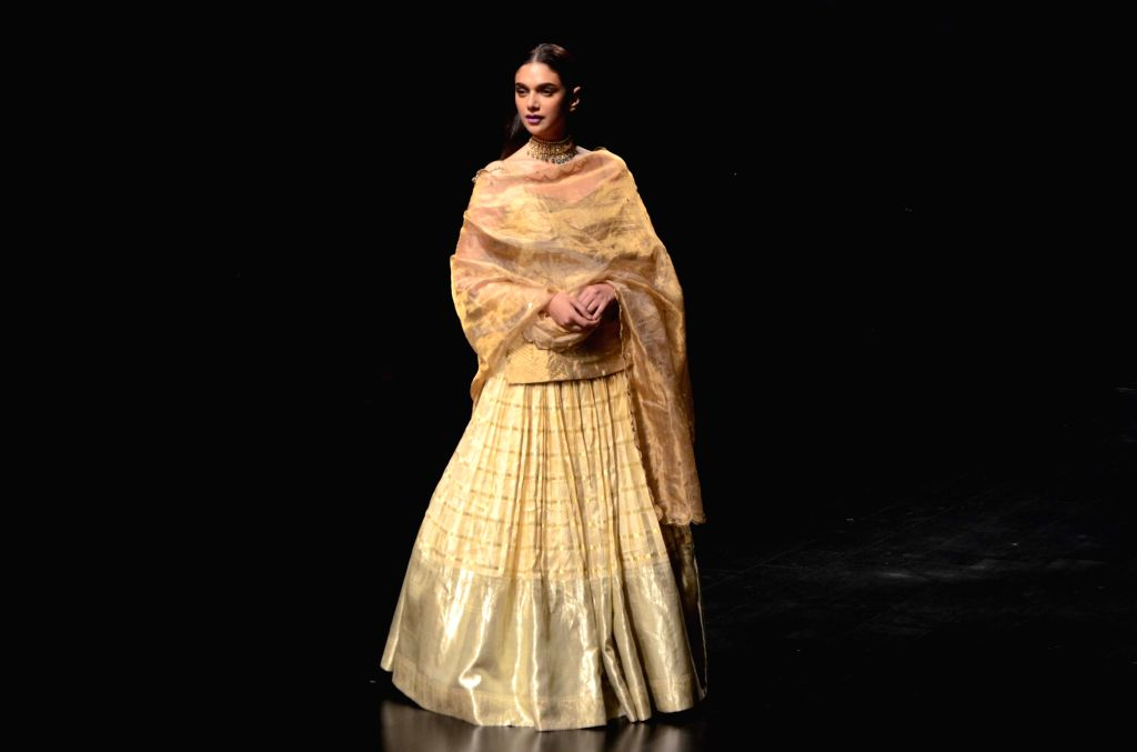 Actress Aditi Rao Hydari showcases fashion designer Latha Puttanna's creation during the Lakme Fashion Week (LFW) Summer/Resort 2019 in Mumbai on Feb 3, 2019. - Aditi Rao Hydari