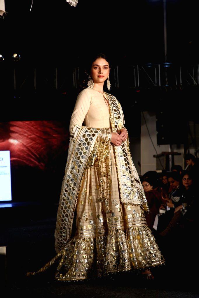 "Actress Aditi Rao Hydari showcases the creations of fashion designers Abu Jani and Sandeep Khosla during ""Khadi Goes Global"" programme, in New Delhi, on Feb 21, 2019. - Aditi Rao Hydari"