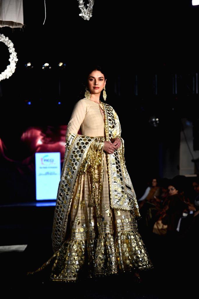"Actress Aditi Rao Hydari showcases the creations of fashion designers Abu Jani and Sandeep Khosla during ""KhadiGoes Global"" programme, in New Delhi, on Feb 21, 2019. - Aditi Rao Hydari"