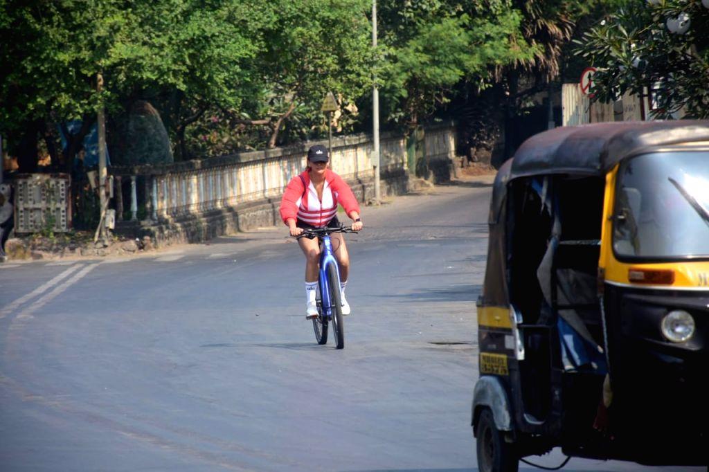 Actress Aisha Sharma seen cycling at Bandra in Mumbai on Nov 30, 2020. - Aisha Sharma
