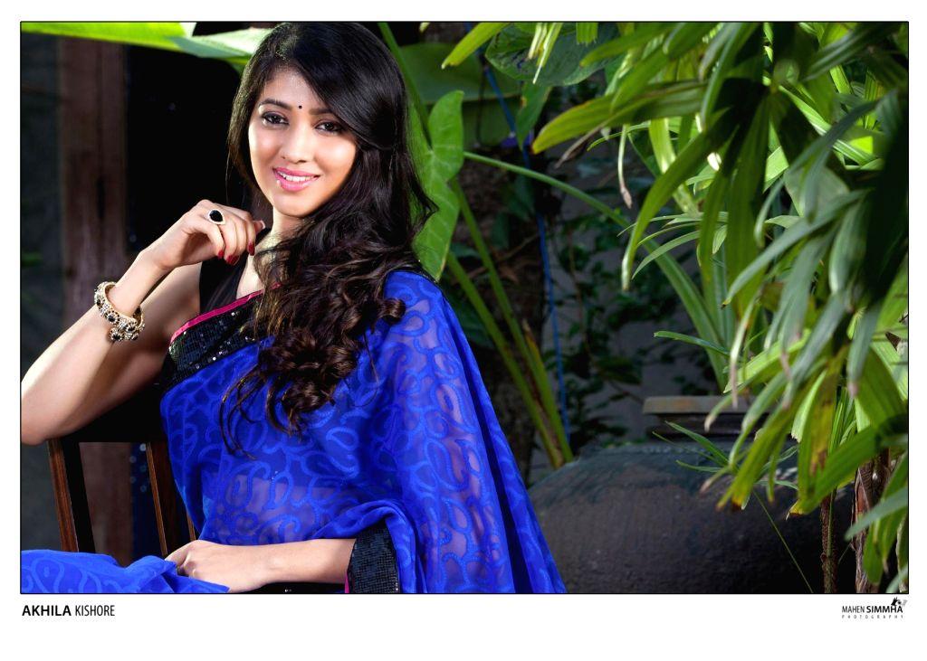 Actress Akhila Kishore poses for a photo during a photoshoot.