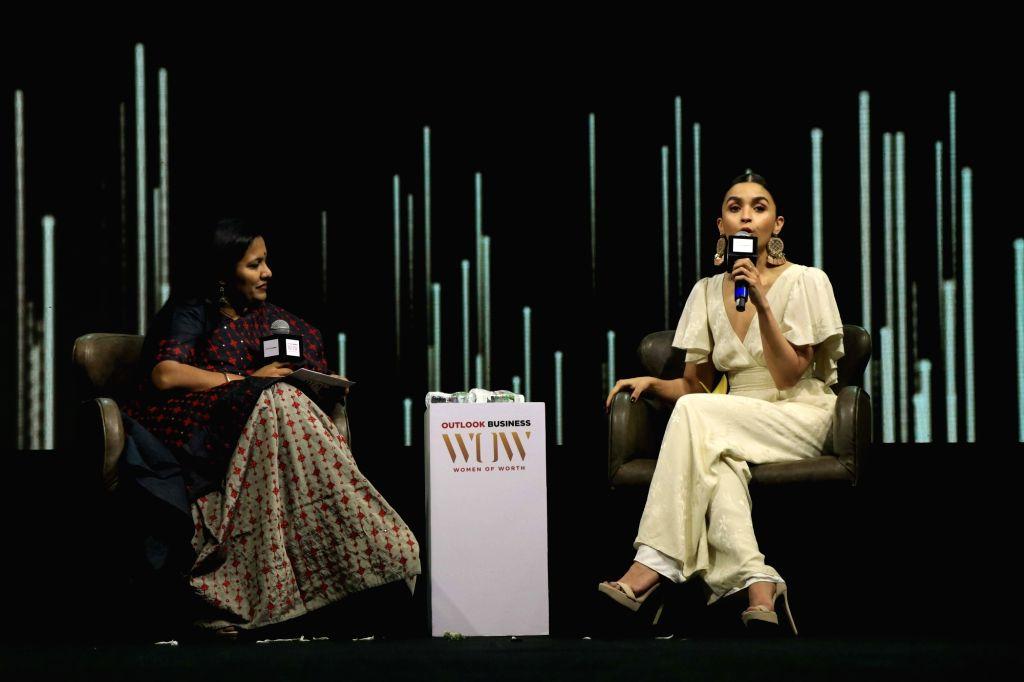 Actress Alia Bhatt addresses at the fourth edition of Outlook Business magazine's 'Women of Worth' awards in Mumbai, on March 6, 2019. - Alia Bhatt