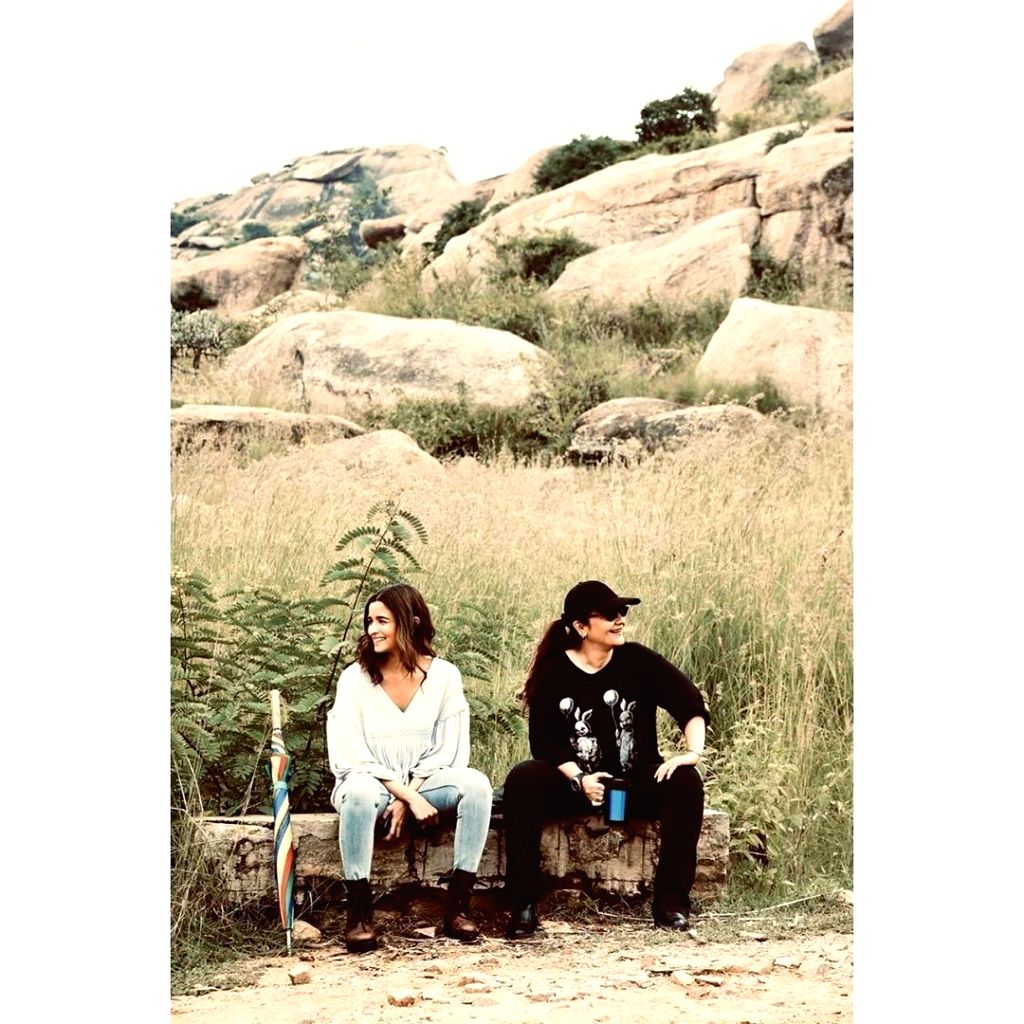 """Actress Alia Bhatt has shared some """"priceless moments"""" with her """"big sister"""" Pooja sister from the sets of """"Sadak 2"""". Alia on Friday took to Instagram and Twitter, where she shared a photograph of herself along with Pooja sitting on a log. Alia is se - Alia Bhatt"""