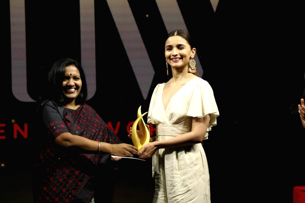 Actress Alia Bhatt receives an award at the fourth edition of Outlook Business magazine's 'Women of Worth' awards in Mumbai, on March 6, 2019. - Alia Bhatt