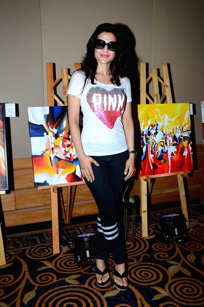 Actress Ameesha Patel during the inauguration of solo exhibition by artist Sharvari Luth in Mumbai. - Ameesha Patel