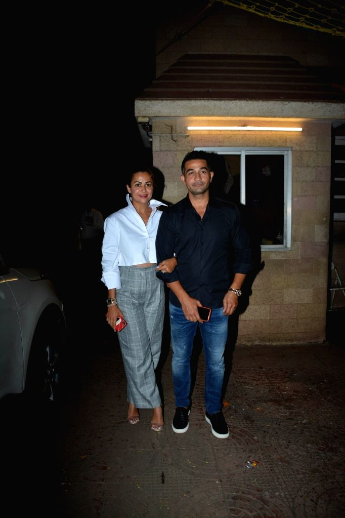 Actress Amrita Arora along with her husband Shakeel Ladak during her mother birthday celebration in Mumbai on Aug 8, 2018. - Amrita Arora