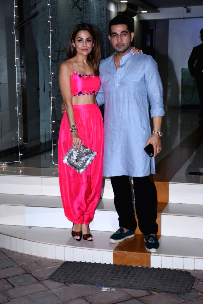 Actress Amrita Arora and her husband Shakeel Ladak at make-up artiste Mallika Bhat's Diwali bash in Mumbai on Oct 25, 2019. - Amrita Arora