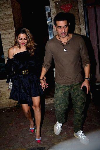 Actress Amrita Arora and her husband Shakeel Ladak at sports agent Bunty Sajdeh's party in Mumbai on March 13, 2020. - Amrita Arora
