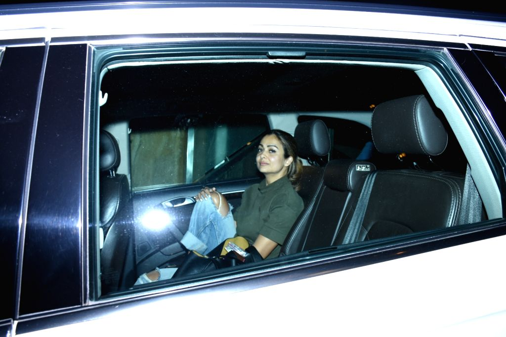 Actress Amrita Arora seen at the residence of actress Kareena Kapoor, in Mumbai on Oct 11, 2019. - Amrita Arora and Kareena Kapoor