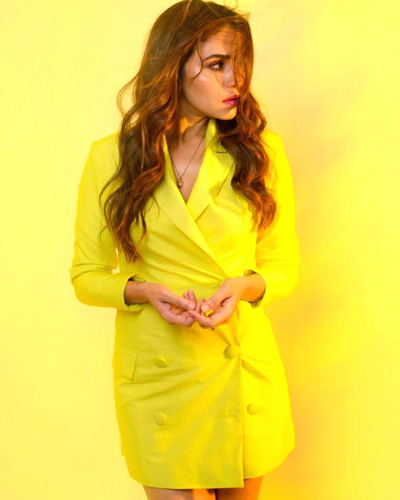 Actress Amruta Khanvilkar made a bright fashionable statement by opting for a yellow blazer dress for her recent outing. - Amruta Khanvilkar