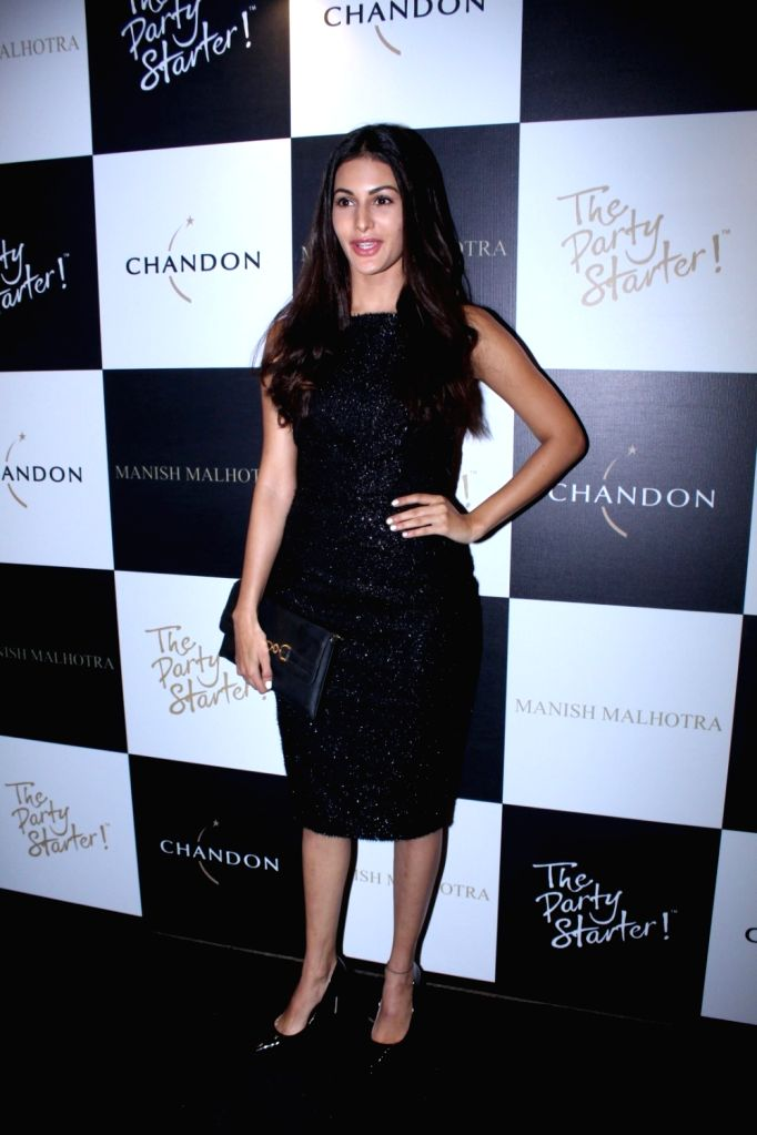 Actress Amyra Dastur during the launch of Manish Malhotra X Chandon Champagne bottles Limited Edition End Of Year 2017 in Mumbai on Oct 9, 2017. - Amyra Dastur