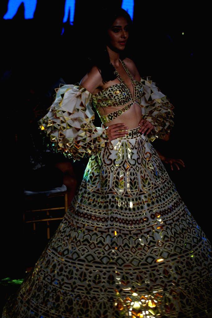Actress Ananya Panday walks the ramp showcasing creations of fahoion designers Abu Jani and Sandeep Khosla in Mumbai on Oct 16, 2019. - Ananya Panday