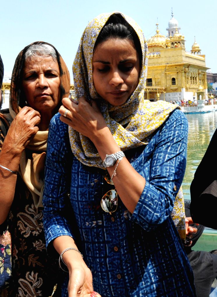 Actress and Aam Admi Party leader Gul Panag paying obeisance at Golden Temple in Amritsar on April 19, 2014.