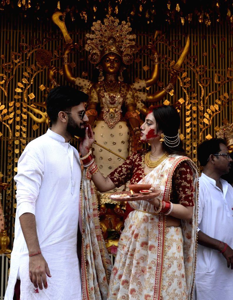 Actress and BJP leader Nusrat Jahan along with her husband Nikhil Jain celebrates 'Sindur Khela' at Chaltabagan in Kolkata on Oct 11, 2019. - Nikhil Jain