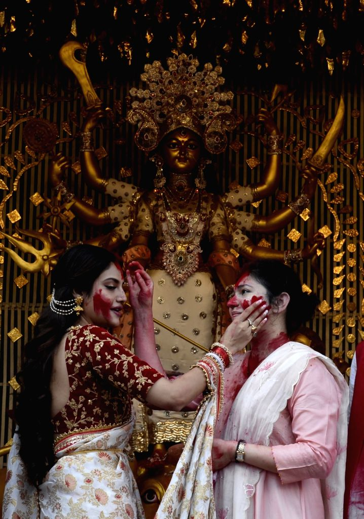 Actress and BJP leader Nusrat Jahan celebrates 'Sindur Khela' at Chaltabagan in Kolkata on Oct 11, 2019.