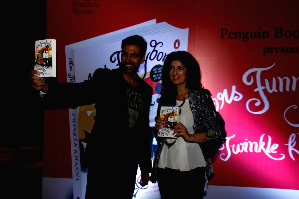 Actress and columnist Twinkle Khanna along with her husband and actor Akshay Kumar during the launch of her book Mrs.Funnybones, in Mumbai, on Aug 18, 2015. - Akshay Kumar