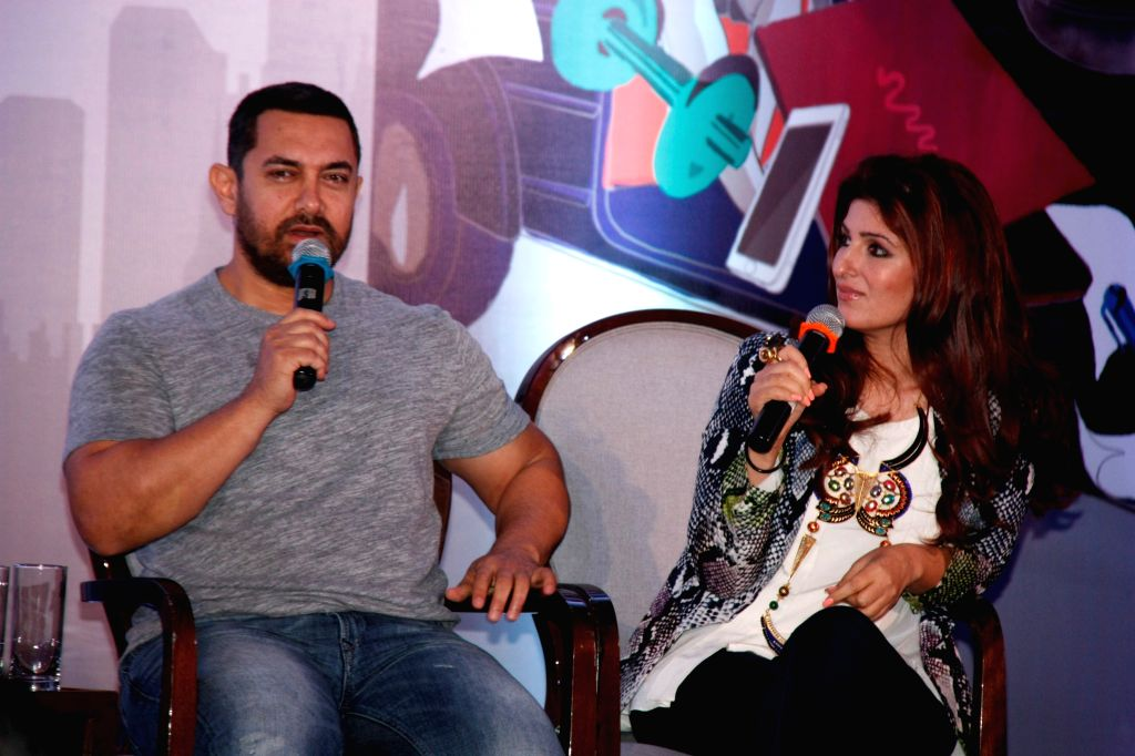 Actress and columnist Twinkle Khanna and Aamir Khan during the launch of her book Mrs.Funnybones, in Mumbai, on Aug 18, 2015. - Aamir Khan