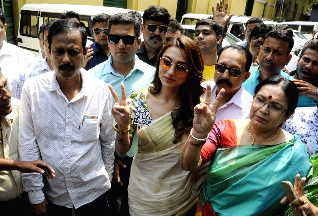 Actress and TMC's Lok Sabha candidate from Jadavpur, Mimi Chakraborty shows victory sign after filing nomination for the forthcoming Lok Sabha elections, in Kolkata on April 26, 2019. - Mimi Chakraborty