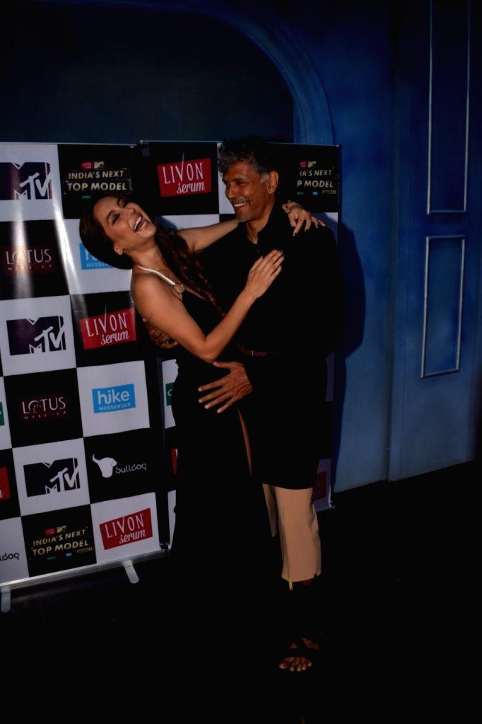 "Actress and VJ Anusha Dandekar and Actor Milind Soman on the set of ""India's Next Top Model"" Season 3  in Mumbai on Oct 10, 2017. - Milind Soman"