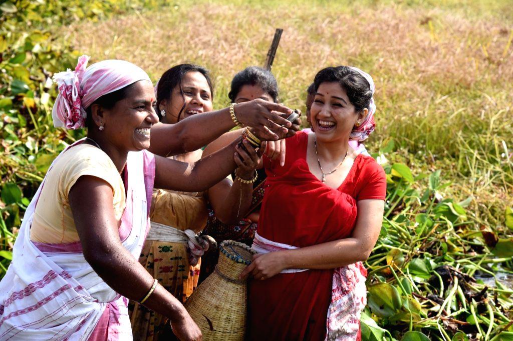 Actress Angoorlata Deka participates in community fishing - a  part of the Bhogali Bihu near Dalangghat in Morigaon district of Assam on Jan 13, 2017. - Angoorlata Deka