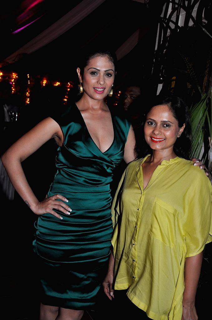 Actress Anjana Sukhani during a success party hosted by Sanjay Gupta to celebrate the success of writer Milap Zaveri's films 'Main Tera Hero', 'Grand Masti' and 'Shootout At Wadala' in Mumbai. - Anjana Sukhani and Sanjay Gupta