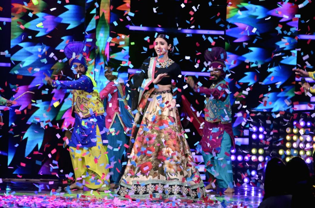 Actress Anushka Sharma performs at the finale stage of TV reality show 'The Voice India' in Mumbai on March 12, 2017. - Anushka Sharma