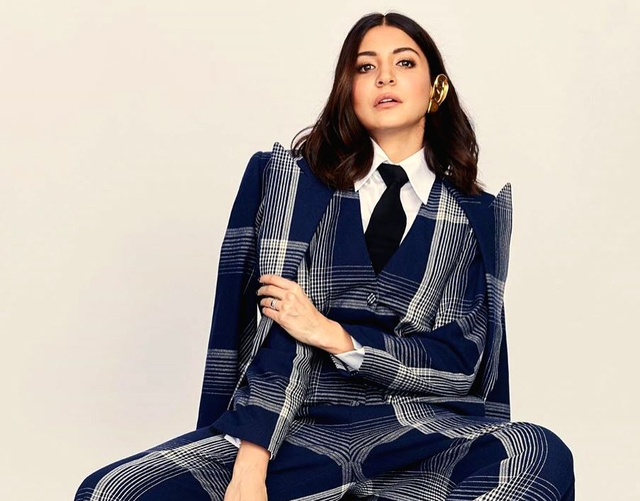 Actress Anushka Sharma took to Instagram to make a statement with her plaid jumpsuit look with formal twist, leaving actors Ranveer Singh and Arjun Kapoor gushing about her fashionable outing. - Anushka Sharma, Ranveer Singh and Arjun Kapoor