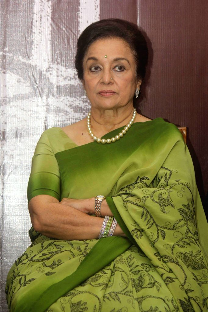 Actress Asha Parekh during the book launch of 4th Dimension written by Architect Chandrakant Patel, in Mumbai on Aug 23, 2015. - Asha Parekh and Chandrakant Patel