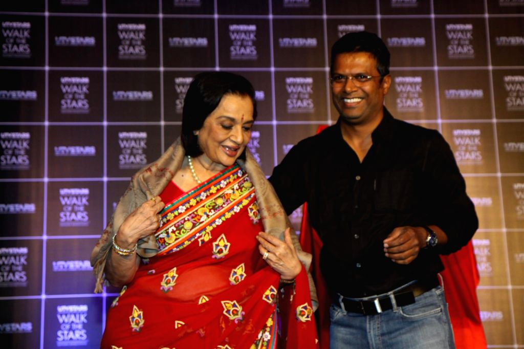 Actress Asha Parekh during unveiling of her hand impression as a tribute to her contribution to the film industry in Mumbai on Dec.6, 2013.