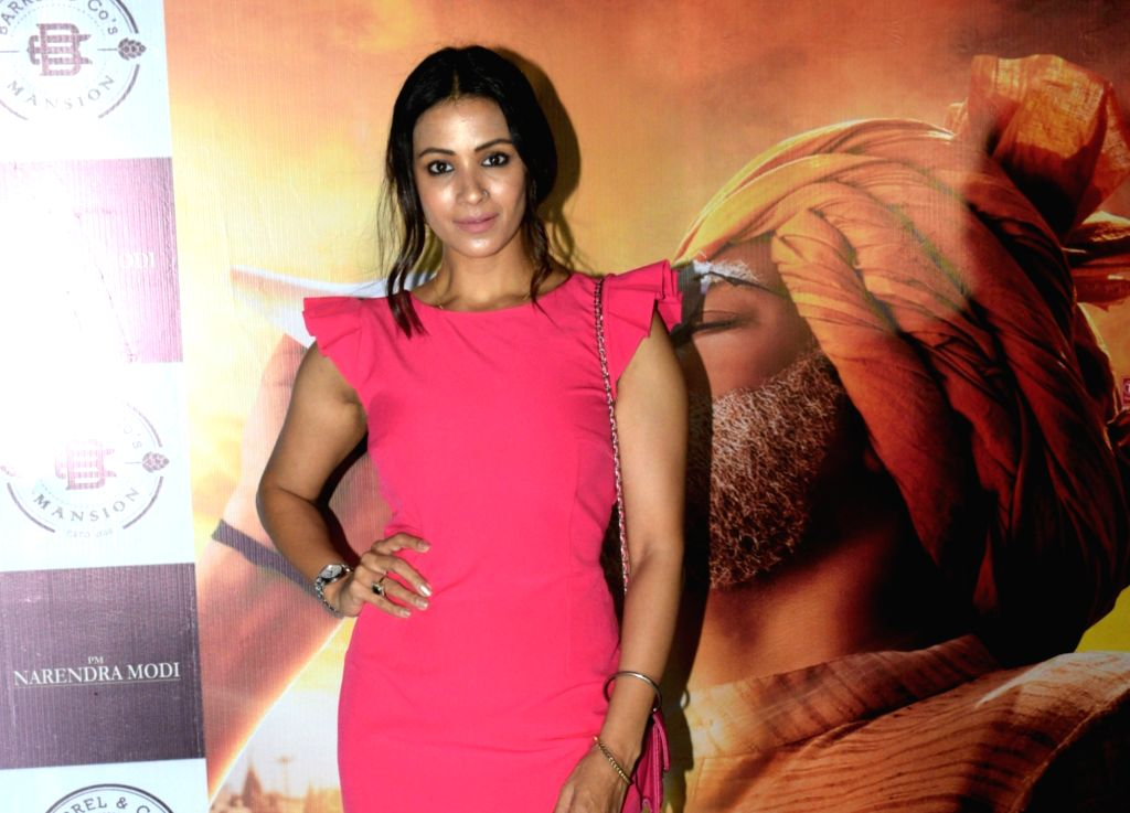 "Actress Barkha Bisht at the success party of her recently released film ""PM Narendra Modi"", in Mumbai, on June 13, 2019. - Barkha Bisht and Narendra Modi"