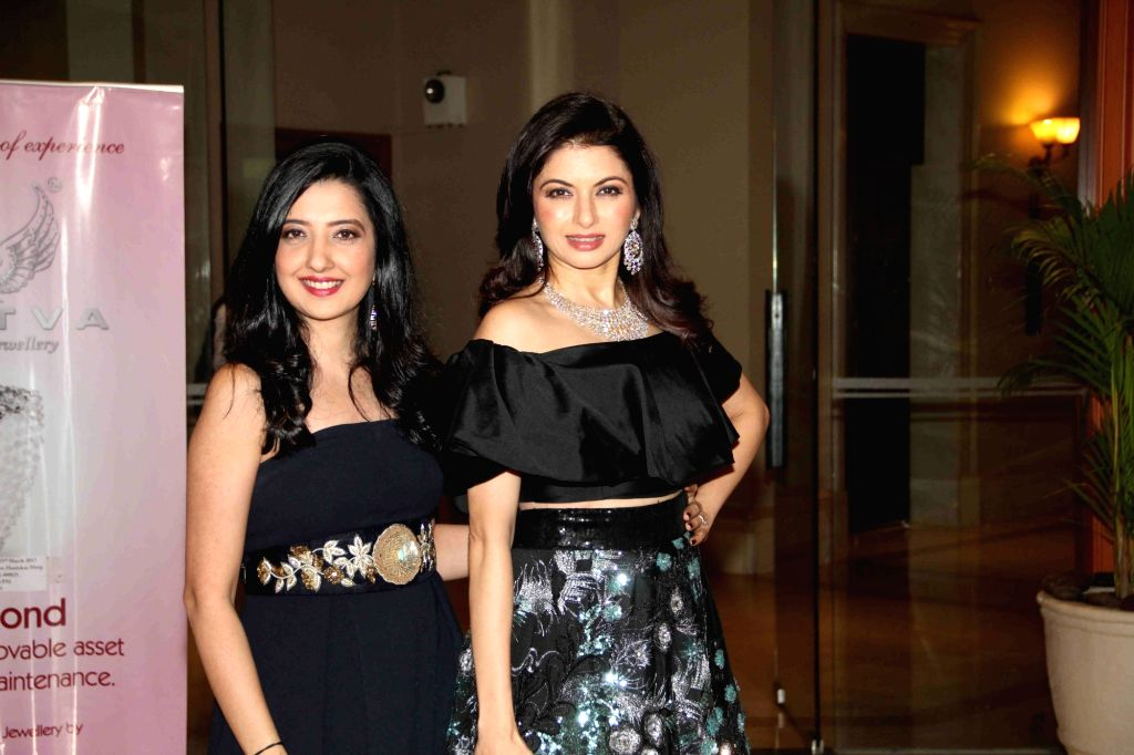 Actress Bhagyashree and fashion designer Amy Billimoria during the Mumbai Obstetrics and Gynecological Society's annual fashion show for Save the Girl Child cause in Mumbai on March 11, 2017. - Bhagyashree