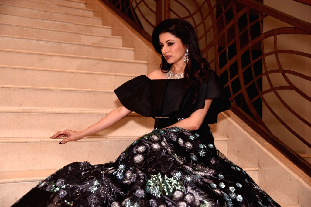 Actress Bhagyashree during the Mumbai Obstetrics and Gynecological Society's annual fashion show for Save the Girl Child cause in Mumbai on March 11, 2017. - Bhagyashree