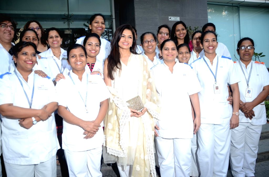 Actress Bhagyashree with the nurses of a healthcare centre on the occasion of International Women's Day in Mumbai on March 8, 2018. - Bhagyashree
