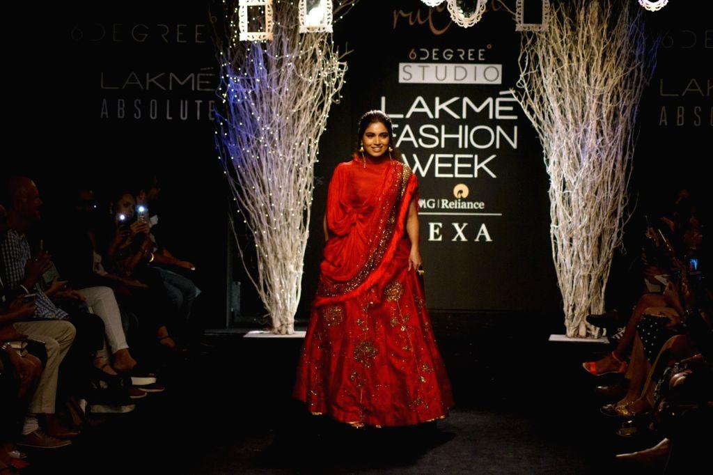 Actress Bhumi Pednekar displays the creation of Ruceru during the Lakme Fashion Week Winter/Festive 2017 in Mumbai on Aug 20, 2017. - Bhumi Pednekar