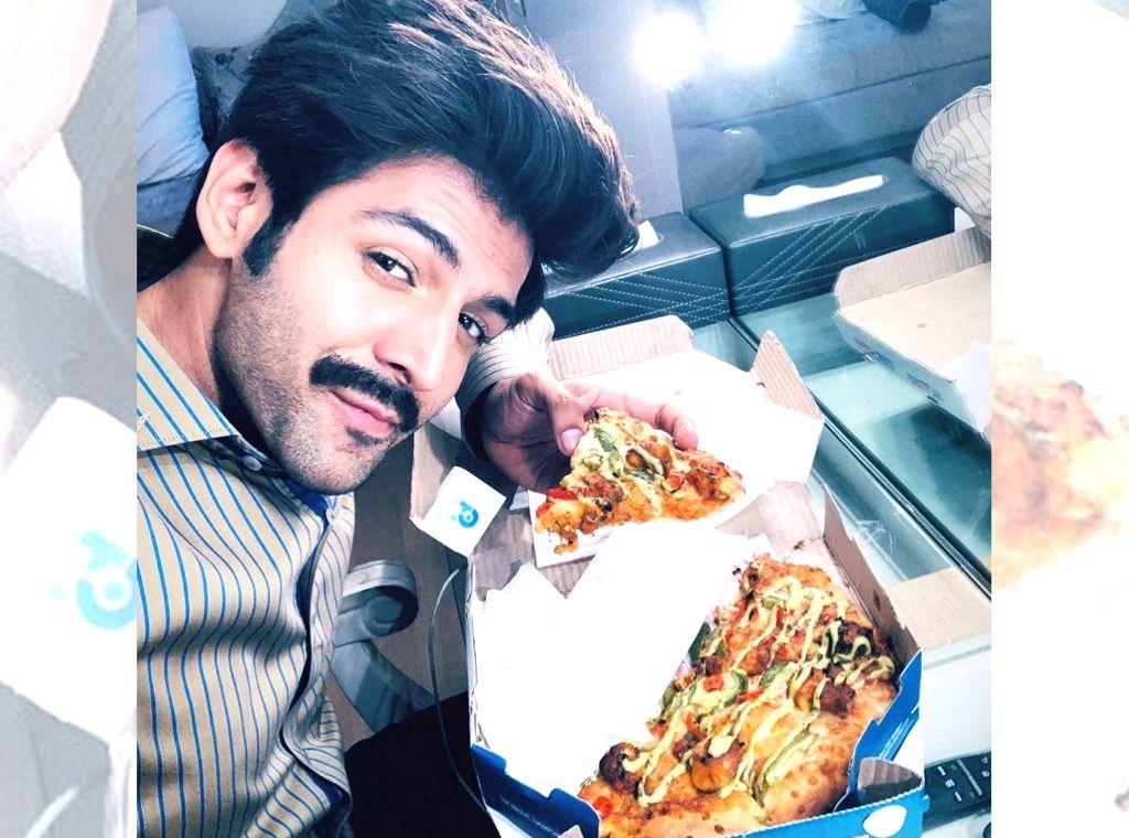 "Actress Bhumi Pednekar sent pizzas on the sets of ""Pati Patni Aur Woh"" for her on-screen ""foodie pati"" Kartik Aaryan. Kartik on Monday shared a photograph of himself enjoying some cheesy pizzas. - Bhumi Pednekar"