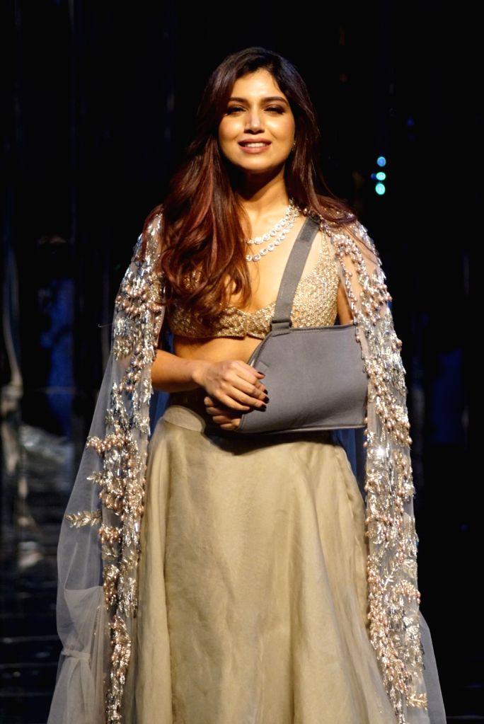 Actress Bhumi Pednekar walks the ramp for fashion designer Manish Malhotra's haute couture show, in Mumbai on Aug 1, 2018. - Bhumi Pednekar and Manish Malhotra
