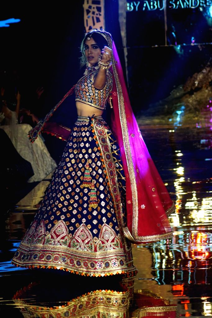 Actress Bhumi Pednekar walks the ramp showcasing creations of fahoion designers Abu Jani and Sandeep Khosla in Mumbai on Oct 16, 2019. - Bhumi Pednekar